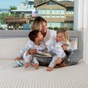 picture of mom and kids on the mattress